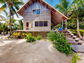 Romantic beachfront home w/ dock, hammock, veranda & outdoor dining!