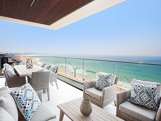 Luxe Beachfront Apartment with Private Balconies