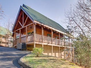 Dog-friendly cabin with private hot tub, community pool & mountain views!