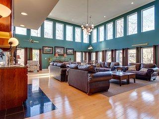 Elegant home w/ mountainside views, a private hot tub, pool, & game room