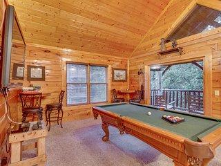 Spacious cabin w/ a private hot tub, game room, & mountain views!