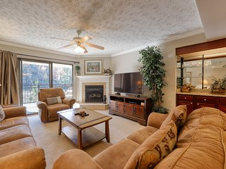 Spacious condo with large private balcony, outdoor dining, & shared outdoor pool