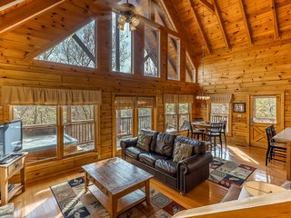 Mountainside log cabin w/ private hot tub, game room & shared seasonal pool!