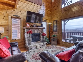 Cabin w/ sweeping mountain views, a private hot tub, & shared pool access!