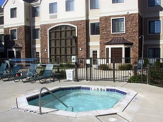 Close to the Airport! | Seasonal Outdoor Pool + Hot Tub + 24 Hour Business