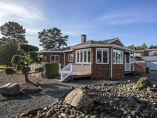 Enjoy this 4 bedroom home moments from the sand in Seaside!