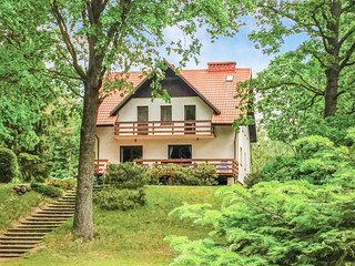 Nice home in Swietajno w/ Sauna, WiFi and 5 Bedrooms (PMA144)