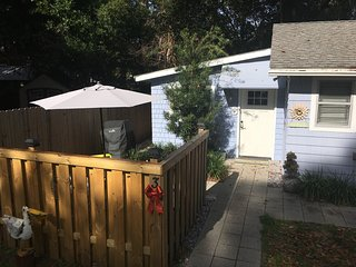 Private patio with seating and grill,  Private entrance