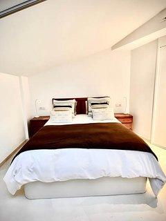 vista cama dormitorio principal estilo colonial étnico