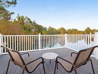 Ground-floor condo w/ shared pool, lake dock & fishing deck - walk to the beach!