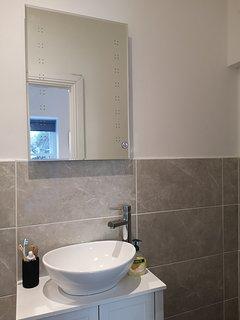En suite bathroom with walk in shower.