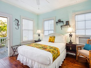 Upper-floor suite in historic home w/ shared on-site pool & semi-private veranda