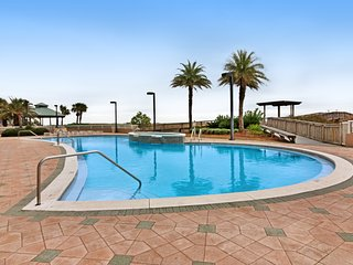 Gorgeous and cozy beachfront condo with shared pool and beach access!