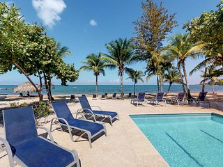 Breezy villa with lush surroundings, walk to the beach & shared pool