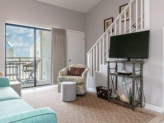 Beachfront condo w/ a spacious living area, shared pools, & easy beach access