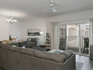 Centrally-located condo with Gulf views, outdoor pool, fitness room, & sun deck