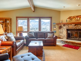 Mountain view condo w/ fireplace & private hot tub - ski-in/out & walk to lifts!