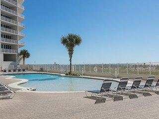 Beachfront family condo w/ balcony & community pools, hot tubs, gym!