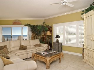 Waterfront condo w/expansive corner balcony, grill area, & multiple shared pools