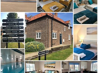 Rock Pool Cottage, The Bay, Filey dogs welcome, pool. beach, bbq, free WiFi