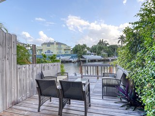 Canal-front townhome w/ dock & waterfront deck - dogs welcome!