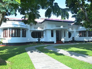 large colonial house with front n back gardens situated in the heart of the city