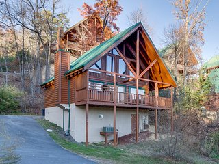 Refurbished log cabin w/ private hot tub, community pool, & mountain views