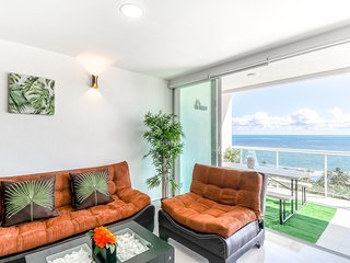 Family apartment w/ ocean & garden view, beach access & shared pool!