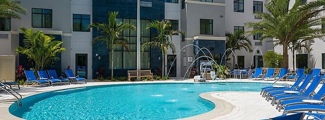 Large heated swimming pool, hot tub, poolside loungers and BBQ grills