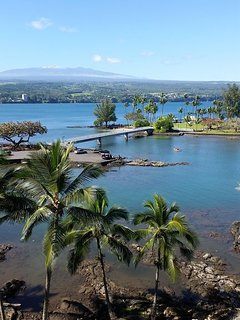Bride to Coconut Island with snow capped Mauna Kea in the background