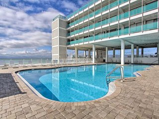 Top floor, beachfront studio w/ a shared, outdoor pool, large decks, & views!
