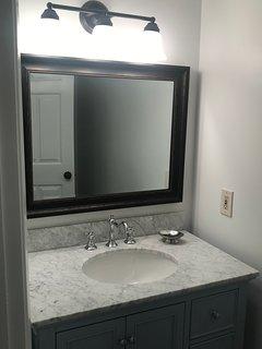 New 1/2 Bath Vanity and Toilet.