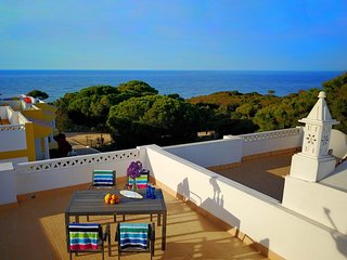 House with good sea views from the roof terrace at walking distance beach