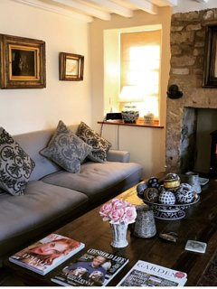 Beautiful sitting room with antiques and paintings plus a log fire.