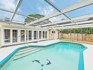 New Listing! Updated Coastal Home w/ Caged Pool & Patio – Near Beach
