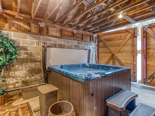 Riverfront log home w/ a hot tub, game room, & two decks - dogs welcome!