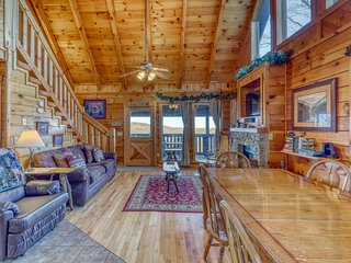Charming log cabin w/ a private hot tub, pool table, & outdoor fireplace