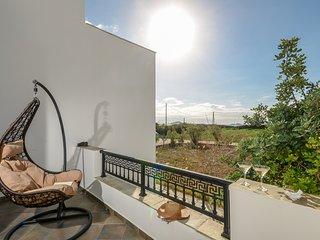 Depis beachfront villas plaka naxos/Vacation house with sea view