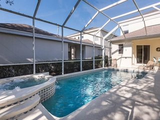 Spacious home with a private pool and spillover spa in Reunion. Small Dogs OK!