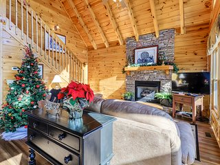 Lovely cabin w/ a private hot tub, beautiful mountain views, & shared pool!