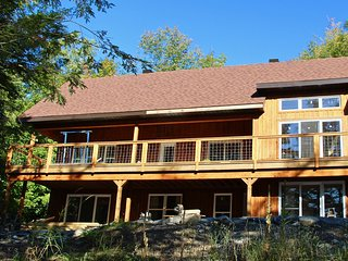 enchanting woodland chalet on Lake Memphremagog, 4-season, private beach, very c