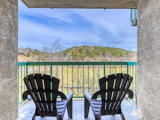 Homey riverfront condo w/ river views, shared outdoor pool, & gas fireplace!