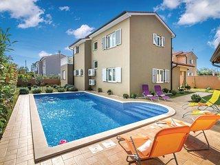 Nice home in Loborika w/ WiFi and 3 Bedrooms (CIC174)