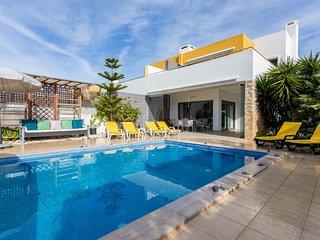Modern semi-detached villa, private pool, garden, AC, free WiFi, walk to beach
