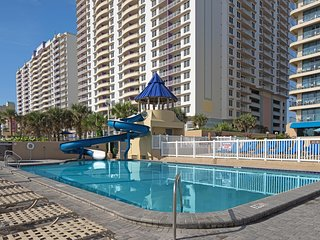 Spacious Condo Steps from the Beach w/ WiFi, Resort Pools, Water Slide & More!