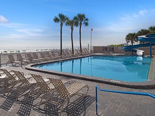 Lovely Condo Steps from the Beach w/ WiFi, Resort Pools, Water Slide & More!