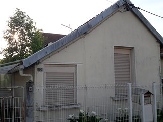 Maison avec sa véranda et son garage