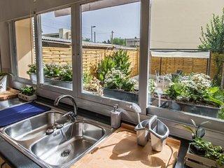 CAN BUADES, planta baja con jardin y garage privado