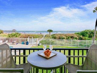 View of the ocean from your bed! Bright direct oceanfront condo near the pier!