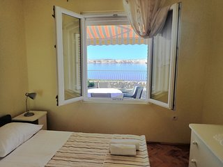 Apartment Jela-on the seafront (58491-A1)